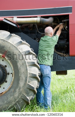 Man changing oil filter on earthmover - stock photo