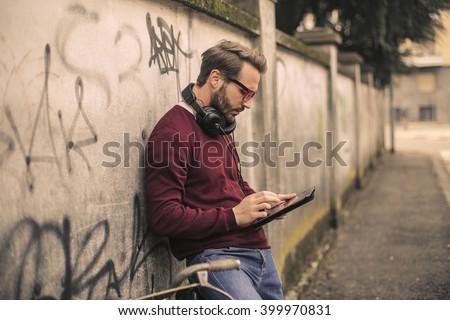 Man checking his tablet - stock photo