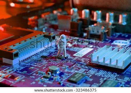 Man checking integrated circuits. The concept technology. - stock photo