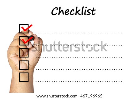 man checking mark on checklist with marker over white