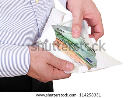 man checking out envelope with cash - stock photo