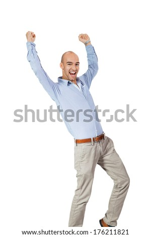 Man cheering in jubilation to celebrate an achievement or success raising his fists and punching the air, isolated on white - stock photo