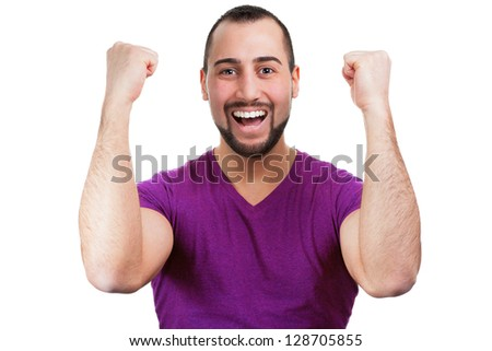 Man cheers and throws his arms in the air - stock photo