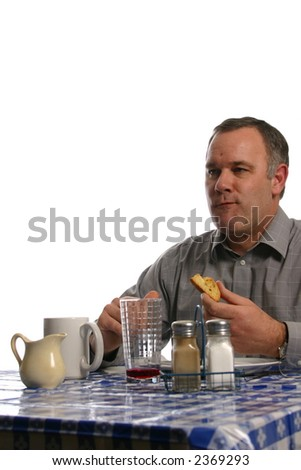 Man chewing and enjoying meal at resturant - stock photo