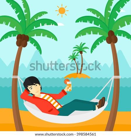 Man chilling in hammock. - stock photo