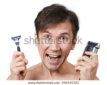 Man chooses between two razors - stock photo