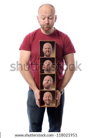 Man choosing Many faces concept symbolizing different emotions or multiple personalities. - stock photo