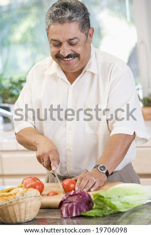 Man Chopping Vegetables - stock photo