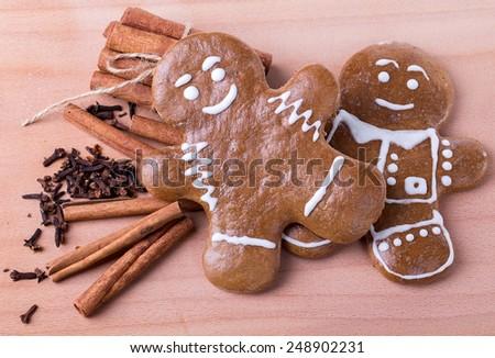 man cinnamon spice cookies wood background - stock photo