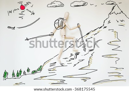 Man clambering to high mountain. Abstract image with wooden puppet - stock photo