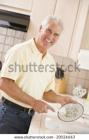 Man Cleaning Dishes - stock photo
