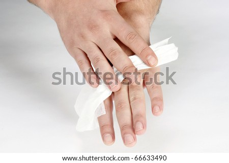 man cleaning hand's with wipes