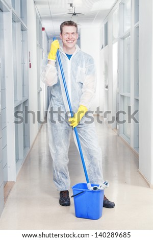 Man cleaning office wearing protective overalls - stock photo