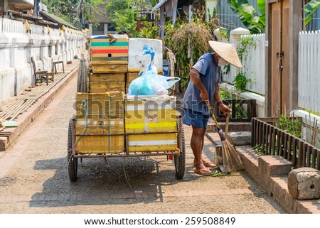 Man cleaning the street. - stock photo