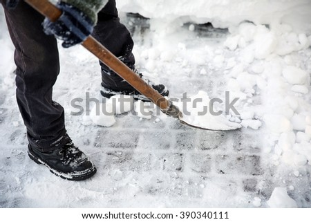 Man clearing street from snow - stock photo