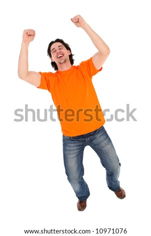 Man clenching his fists and laughing - stock photo