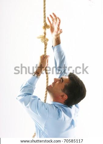 Man climbing a breaking rope. - stock photo