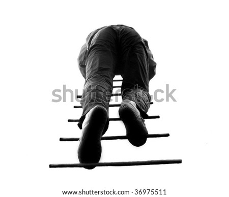 man climbing a ladder, isolated on a white background. - stock photo