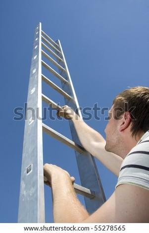 Man climbing ladder - stock photo