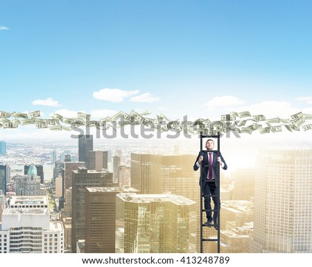 Man climbing ladder to dollar banknote path over sunlit New York - stock photo