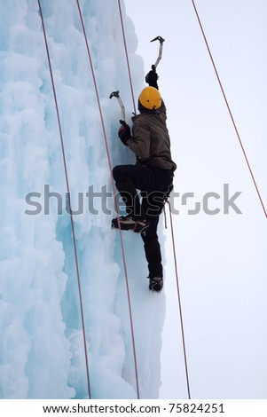 Man climbing on the ice