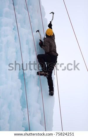 Man climbing on the ice - stock photo