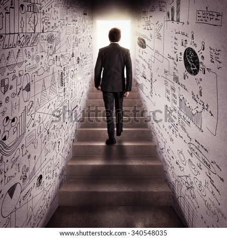 Man climbs stairs to a passage lit - stock photo