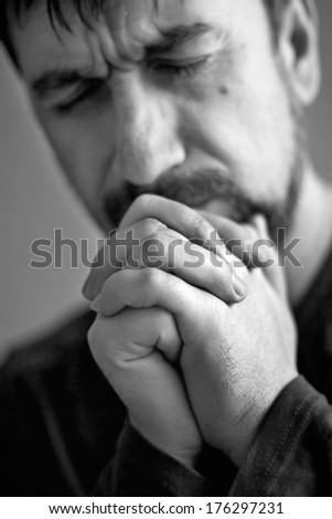 man closed his eyes to pray - stock photo