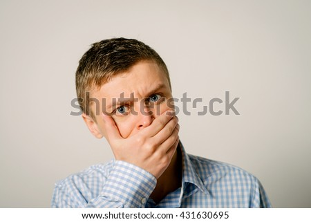 man closes a mouth hands - stock photo