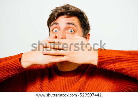 man closes a mouth hands