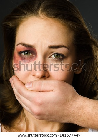 man closes his mouth crying girl - stock photo