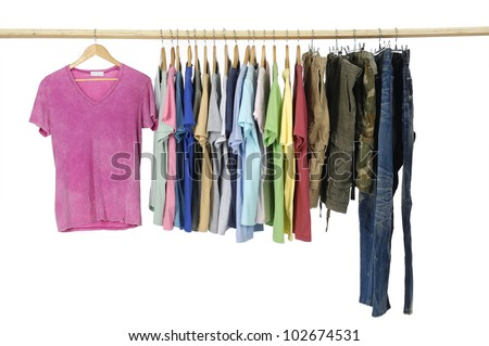 man clothes of different colors shirt with trousers on wooden hangers - stock photo