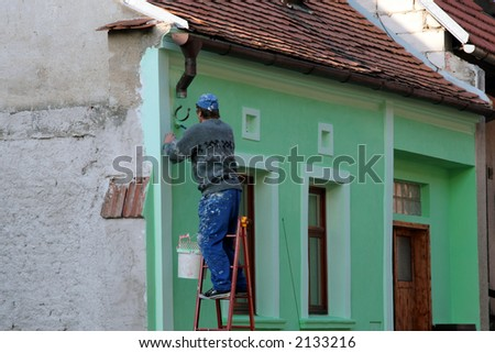 Man color the wall. - stock photo