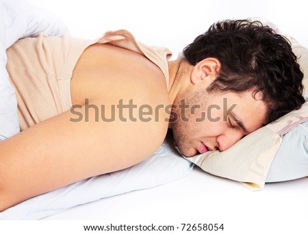 Man comfortably sleeping in his bed - stock photo