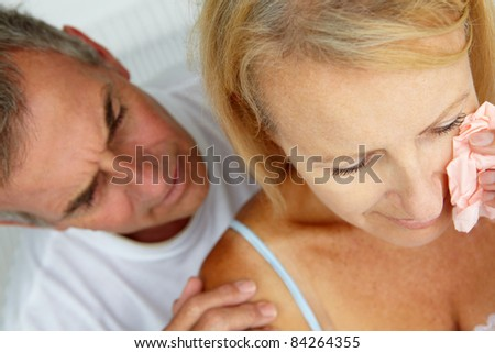 Man comforting crying wife - stock photo