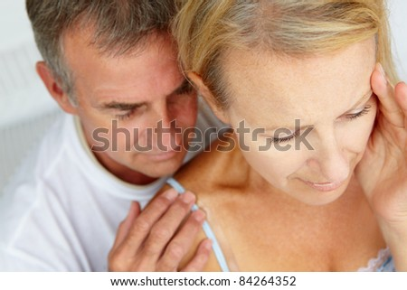 Man comforting distressed wife - stock photo