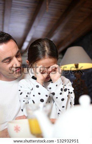 Man comforting his daughter - stock photo