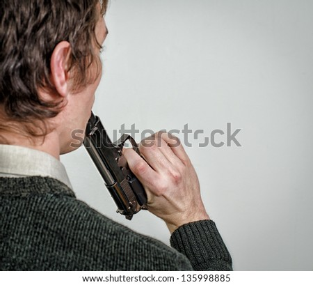 Man commit suicide. Back view - stock photo