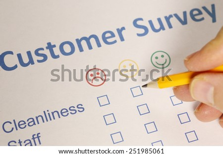 Man completing a customer survey - stock photo