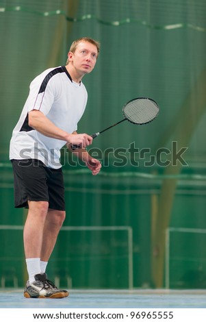 Man concentrate to the badminton game, low angle shot. - stock photo