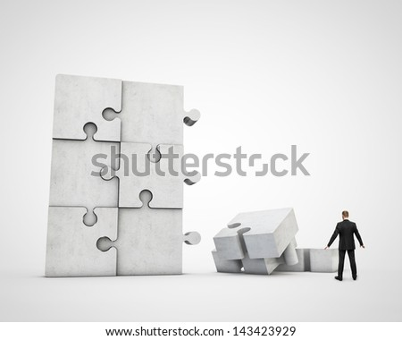 man constructing puzzle - stock photo