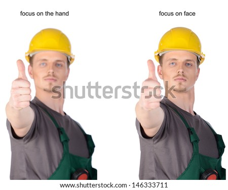 Man construction worker in overalls and helmet holding ruler tape. Isolated on white background. - stock photo