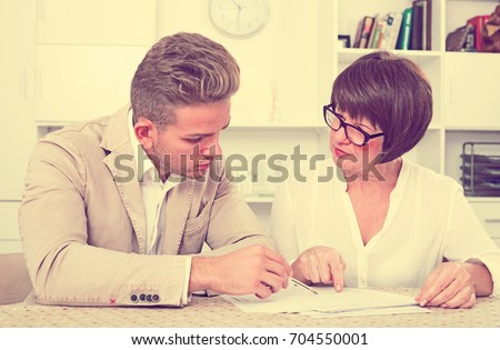 Man consults at the familiar mature lawyer concerning paperwork