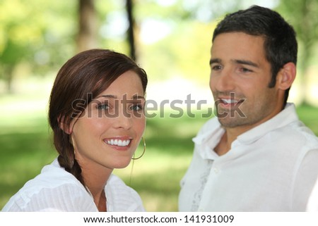 Man contemplating brown-haired woman - stock photo