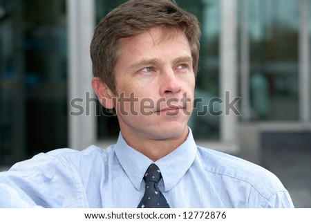 Man contemplating outdoors in city - stock photo