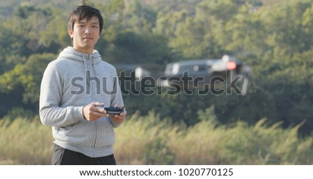 Man control flying drone at outdoor