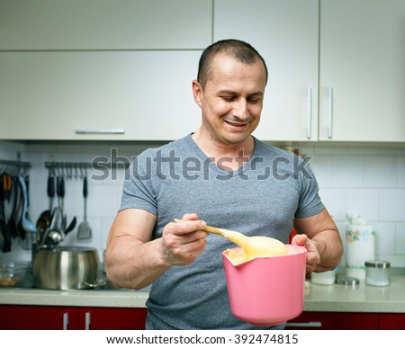 Man cooking alone at home a cake recipe - stock photo