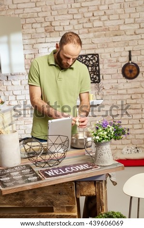 Man cooking in kitchen. - stock photo