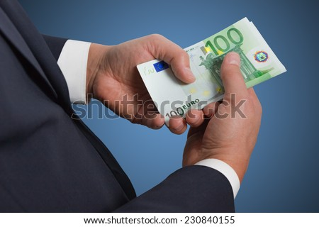 Man counts money euro  isolated on blue background