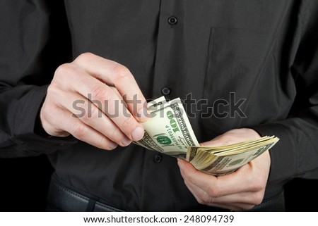 man counts money in hands dollar usa